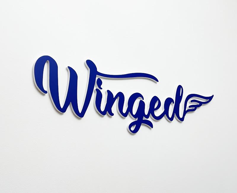 Logo 3D na ścianę dla firmy Winged od Studio Efekt